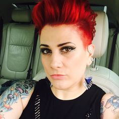 Red hair shaved faux hawk