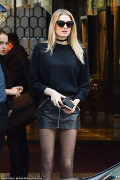 Pins: Martha Hunt showed off her long, lean legs in a black miniskirt and patterned tights...