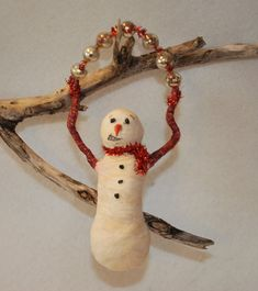 Hand spun cotton Primitive snowman hanging ornament. We waited for snow, school to be closed - to build a snowman out back in the yard. We scoured the school yard for bits of coal, always a carrot found in the fridge, an old woolen scarf so he wouldn't get cold..for arms the fig tree branches
