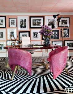 A graphic striped carpet was custom made by the Rug Company for a contemporary office/library by Kelly Wearstler