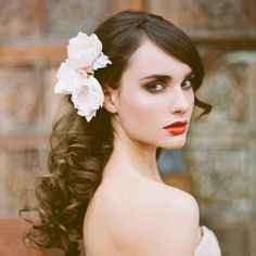 All down wedding hairstyle with bouncy waves
