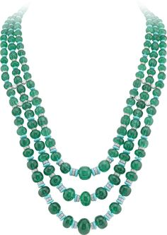 Van Cleef & Arpels Peau d'Ane Enchanted Forest collection necklace in white gold with 188 emerald beads totalling 555.37ct, round diamonds, round and pear-cut sapphires, emeralds, malachite and turquoise.