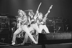 Status Quo perform on stage Bingley Hall Stafford January 9th 1977 LR Rick Parfitt Francis Rossi Alan Lancaster