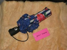 """For Sale on EBay currently: Prices REDUCED on ALL items!! Only until the end of the year!! Betsey Johnson """"Rosie Garden"""" Blue/White Striped Umbrella"""