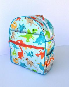 Fun boy dinosaur back to school backpack. Made with Little Smilemakers Studio fabric available via Spoonflower.
