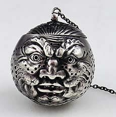 T5576 Gorham Man in the Moon Antique Sterling Tea Ball    A rare Gorham man in the moon tea ball circa 1890 in excellent condition with intricate details and piercing.    Marked with Gorham marks.    Price: $2,900.00