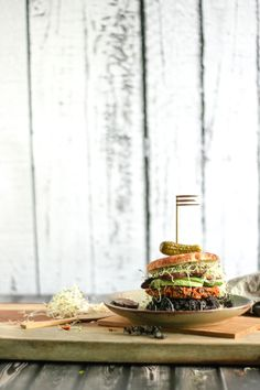 A recipe for black bean burgers that will knock your socks off! This veggie burger recipe is loaded with fresh veggies, cumin, chili powder & black beans. http://sheeats.ca/2015/02/black-bean-burgers/