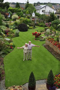 Anne and Stuart Grindle stand on the hallowed turf, proudly showing off their immaculate garden at their home in Rotherham, Yorkshire
