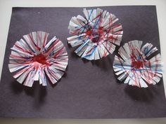 Coffee filter fire works (or cupcake liners.. marker, glitter, glue, black construction paper)