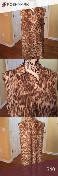 Chico's size 2 (large) sheer hi-lo top. NWT Chico's size 2 (large) brown and cream hi-lo sleeveless top. NWT. Bust measures about 20 inches Chico's Tops