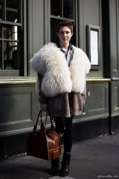 White fur vest, long brown cardigan, leather bag, black ankle boots / Garance Doré