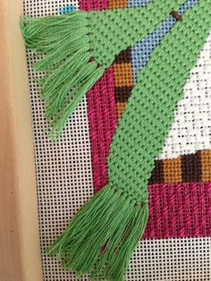 Great scarf fringe on needlepoint piece
