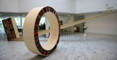 Step in and roll over the 'Circular Walking Bookshelf' to access the books