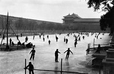 Marc Riboud - Skating in front of the Forbidden City, China, 1957.
