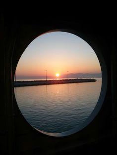 Sunrise over harbor of killini Greece
