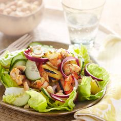 Hawaiian Grilled-Shrimp Salad - Get a taste of island life with this refreshing salad that features grilled shrimp, pineapple, cashews, and cucumber dressed in a unique blend of Asian flavors.