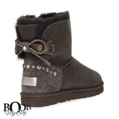 FEATURES - Metallic twinface sheepskin uppers - Suede heel guards with metallic UGG logo - Fixed grosgrain bow and braided leather bow - Swarovski crystals with patina and studs - UGGpure lining - Pat