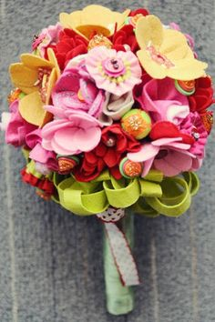 The bride held a quirky bouquet made of felt flowers, buttons, and beads. - From Camille & Peewee's Wedding