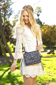 Balance the bridal vibe of a white lace dress with a cute printed bag.   - Seventeen.com