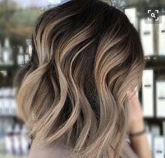 Brown hair with blonde head of highlights Short-Medium haircut