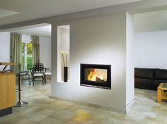 Good Images double sided Fireplace Remodel Style Inset Stove – This wood-burning double-sided stove is ideal for installing in a wall that Wood Fireplace Surrounds, Log Burner Fireplace, Fireplace Seating, Simple Fireplace, Fireplace Cover, Fireplace Shelves, Fireplace Hearth, Fireplace Remodel, Living Room With Fireplace