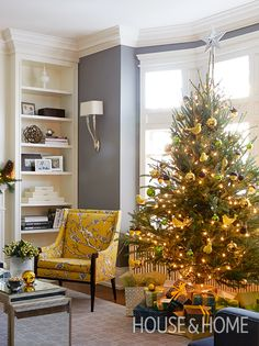 The color-coordinated trimmings on this Christmas tree match the statement yellow chair, making the seasonal decorations feel like part of the room rather than add-ons. | Photographer: Virginia Macdonald | Designer: Collen McGill
