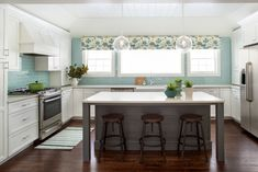 white kitchen with turquoise subway tile backsplash | Two Hands Interiors