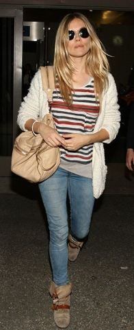 Who made Sienna Miller's pocket cardigan sweater, stripe tee, and buckle strappy boots that she wore at LAX airport on November 8, 2011?