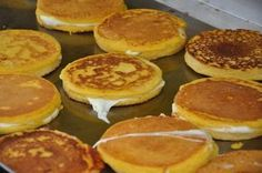 """Corn Pancake Sandwiches """"Arepas de Choclo"""" on BigOven: The traditional arepa served in Miami has two cornmeal pancakes with a layer of cheese inside. Anything to do with cornmeal pancakes, I'm in. Corn Pancakes, Cornmeal Pancakes, Venezuelan Food, Colombian Food, Colombian Arepas, Colombian Recipes, Colombian Cities, Comida Latina, Cuban Recipes"""