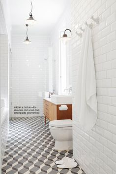 Modern bathroom with beveled subway tiled walls, repurposed mid-century modern credenza turned bathroom vanity with vessel sink and polished nickel wall-mount faucet, vintage barn pendants and black and gray geometric tile floor. Modern Interior Decor, Bathroom Inspiration, Apartment Interior, Mid Century Modern Bathroom, Bathrooms Remodel, Bathroom Floor Tiles, Bathroom Design, Bathroom Flooring, Tile Bathroom