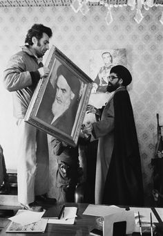 Palace employees replace the portrait of the Shah Reza Pahlavi with a portrait of the Ayatollah Ruhollah Khomeini at the Niavaran Palace in Tehran. Get premium, high resolution news photos at Getty Images Ruhollah Khomeini, Supreme Leader Of Iran, Iran Girls, Iran Tourism, Iran Pictures, The Shah Of Iran, Pahlavi Dynasty, Persian Architecture, Shiraz Iran