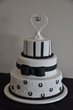 Black and white horse theme wedding cake - Topper is kinda awful, but would be cute with the black and white striped bridesmaid dresses in the other pic on this board.