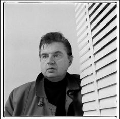 John Deakin: Francis Bacon, mid-1960s    Francis having his portrait taken with blinds in foreground. A. Ensor / Press.