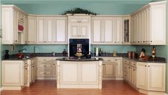 Cream kitchen cabinets  - like the wall paint with floor color
