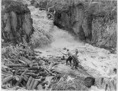 The very dangerous job of clearing a log jam.