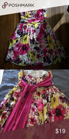 "Twenty one tube dress shirt length size M NWT Floral Twenty one shirt length dress/tube. Cream pink yellow. Dress is 26 1/2"" from top to bottom. Zips at back area as well As a ribbon tie in back. Waist approximately 26"" flowy dress.  Gorgeous summer colors. twenty one  Dresses Backless"