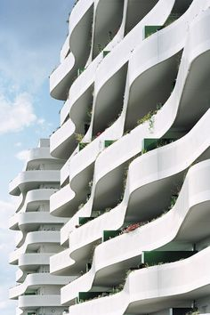 ECDM have completed the ZAC du Coteau housing complex in the suburbs of Paris, France. The two buildings feature undulating balconies that provide abundant outdoor space for the residents.