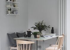 Muuto's 70/70 table by TAF Architects is a minimal design with a plywood top + metal legs that perfectly fits into this grey, Scandi-inspired kitchen