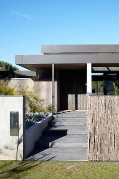 "Melbourne-based architectural firm Inarc Architects has created the Bellarine Peninsula House. Completed in 2010, this contemporary homes is located in Barwon Heads, Australia. Bellarine Peninsula House by Inarc Architects: ""Single level home with double height central living area and separated sleeping wings for parents and children. Dual courtyards on either side of living area offer controlled landscape views. A seaside palette of grey rough sawn timber, dark bronze and agein..."