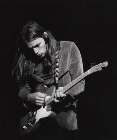 David Gilmour - Pink Floyd - This is probably the Telecaster he used and posed for photos with for the About Face solo album. Hard to tell from b&w. In any case, not his usual stage choice from his guitarsenal.