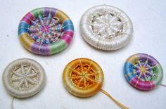 Dorset buttons of the Blandford Cartwheel design.