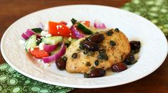 Greek dressing is used as a chicken marinade and salad dressing in this easy and simple Greek chicken dinner.