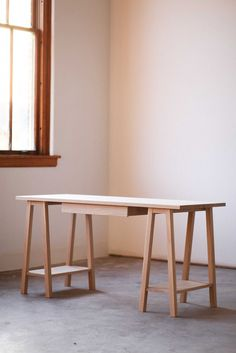 Saw Horse Desk- I am going to do this for a backyard dinging table. Except I have an old door I am going to use for the top, benches for seating.