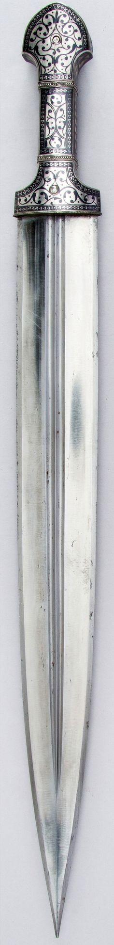 Caucasian (possibly northern Dagestan) qama dagger, ca. 1840–50, steel, wood, silver, niello, Met Museum.