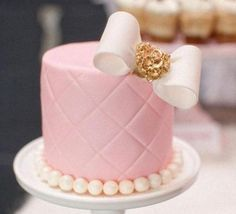 light pink mini wedding cake wih bow