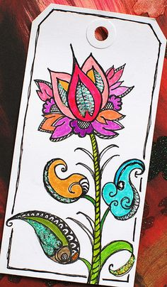 """Art Tag created with: - Flower and leaves drawn with Sakura Pigma Micron pens, colored with Tombow markers, and embellished with Stickles glitter glue.   - The floral image and leaves were inspired by designs found in the book """"5000 Flower & Plant Motifs"""" by Graham Leslie McCallum.   - Tag measures 2 3/4"""" x 5 1/4"""""""