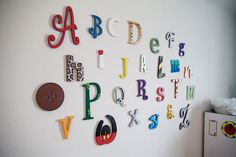 Ask each guest to bring a letter decorated to put in the baby's nursery. LOVE this idea!