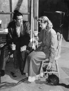 """Ingrid and Gregory Peck on the set of """"Spellbound""""."""