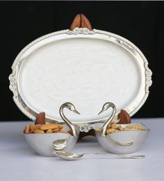 Trays with 2 Swans and Spoon http://www.thedivineluxury.com/product/Trays-with-2-Swans-and-Spoon.html A classic collection with a silver plated platter and two swan shaped bowls with a spoon to create a master piece for the kitchen that will leave every guest mesmerized.
