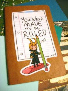 Loki notebook. With ruled paper. ;) I used a wet (Elmer's) glue to cover a composition notebook with brown wrapping paper and a glue stick to attach the image. Cover the ENTIRE surface of the notebook or the paper will come off. Let the Elmer's dry first (hair dryer, anyone?) before attaching the Loki image.